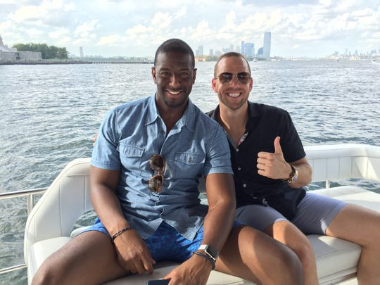 Andrew Gillum and lobbyist/friend Adam Corey during a New York harbor boat ride with undercover FBI agents and his brother Marcus.