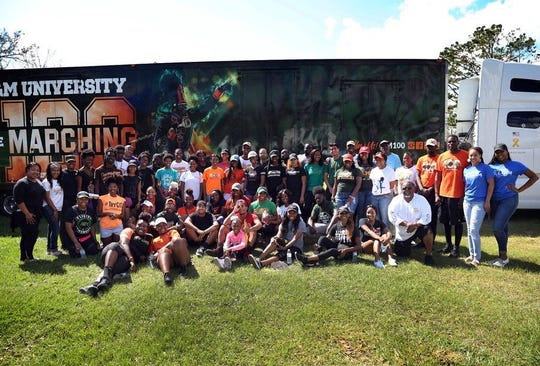 Shelby Chipman, director of bands at Florida A&M University and members of the Marching 100 took supplies to Marianna.