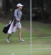 Chiles junior Trey Buehler heads up to the green to mark his ball after he nearly holes a tee shot during the Region 1-3A tournament at Killearn Country Club on Tuesday, Oct. 23, 2018.