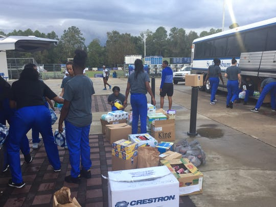 TCC basketball players help collect relief items for hurricane victims during the Eagles' jamboree last Saturday at Maclay.