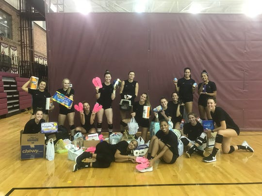 Members of the Seminoles volleyball team pose with donations given last weekend for hurricane relief