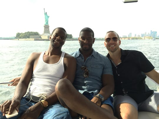 Brothers Marcus and Andrew Gillum and lobbyist/friend Adam Corey during a New York harbor boat ride with undercover FBI agents.
