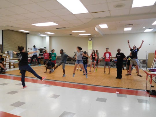 Taylor Whittle leads the movement portion of the class at Leon High.