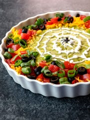 Spooky 8-Layer Taco Dip takes five minutes to put together.