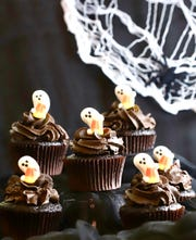 Scare up some chocolate with Halloween cupcakes.