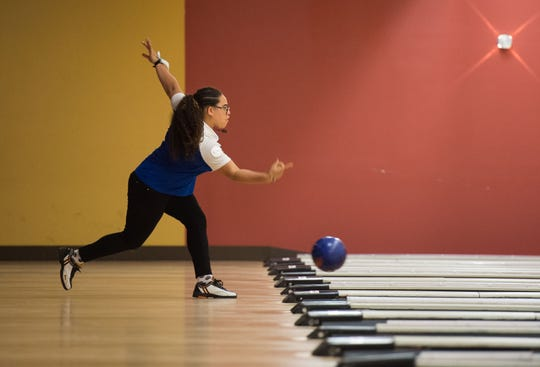 Martin County's Isabella Branch competes in the District 12 high school bowling tournament Monday, Oct. 22, 2018, at Stuart Bowl in Stuart. Bowlers from Fort Pierce Central, Fort Pierce Westwood, Jensen Beach, Lincoln Park Academy, Martin County, Okeechobee, Port St. Lucie, St. Lucie West Centennial, Sebastian River, Sebring, South Fork, Treasure Coast and Vero Beach competed for a trip to the state tournament at Boardwalk Bowl in Orlando.