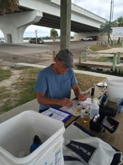 Volunteer Paul Laura monitorsthe mosquito impoundment on the northeast side of the Jensen Beach Causeway, as well as 13 stations in the impoundment behind Florida Oceanographic Coastal Center.