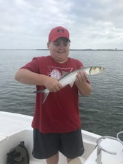 Wyatt enjoyed catching ladyfish, snapper and jacks with the family on a beautiful morning on the Indian River.