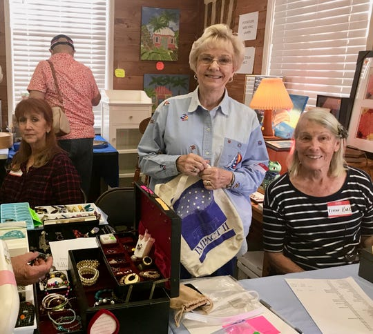 At the indoor sale, club president Blanca Rancourt, Patty Cawthorne and Vivian Kobe are ready to package your selections as you check out.