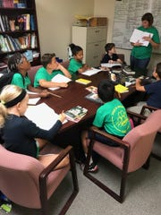 Rosewood Elementary students meet for their first Book Club, where they are setting up their group discussion rules and selecting their first book.