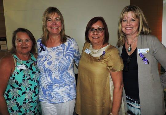 Liz Bonan, left, Jill Keegan, Terri Pettengill and Kat Rock, past, current and future presidents of Soroptimist International of Stuart, at the district meeting of Soroptimist International of the Americas Southern Region I & II.