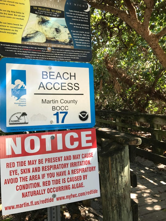 A sign at the entrance to Virginia Forrest Beach in Martin County warns visitors of possible red tide.