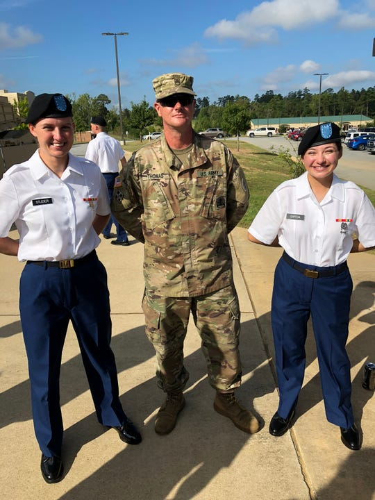 New recruit Angel Studer with Tank Commander Sgt. Bryan Thomas and fellow recruit August Garcia.