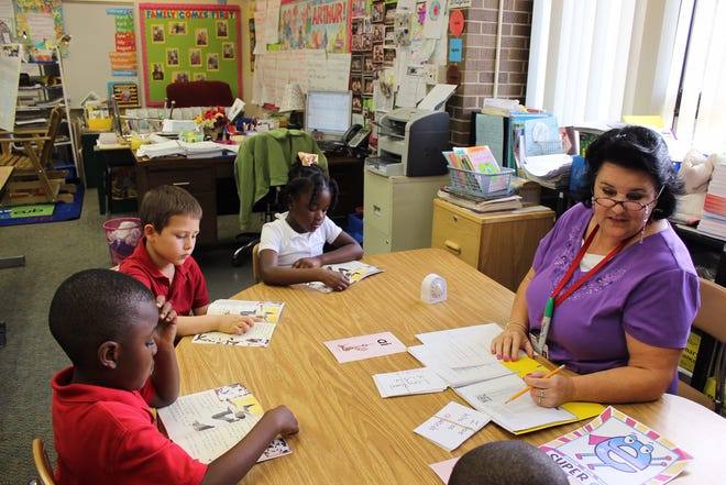 The Moonshot Academy offers students extended learning opportunities with small group tutoring after school and in summer. Here, students at Indian River Academy participate in a lesson.