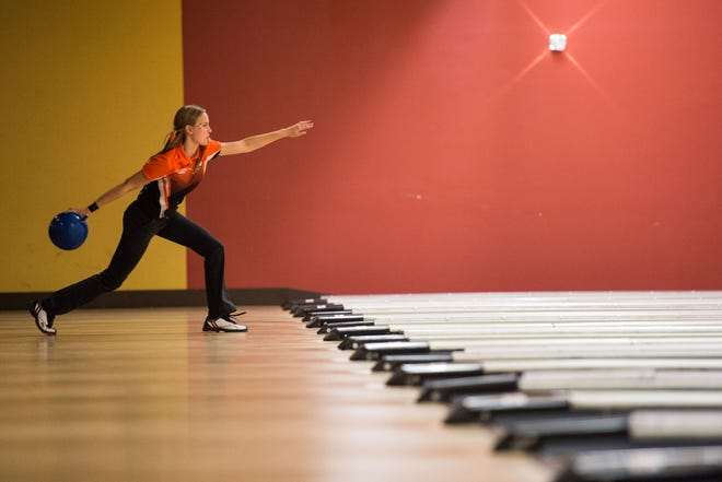 Lincoln Park Academy's Sydnei Favorite prepares to release during the District 12 high school bowling tournament Monday, Oct. 22, 2018, at Stuart Bowl in Stuart. Boys and girls from Fort Pierce Central, Fort Pierce Westwood, Jensen Beach, Lincoln Park Academy, Martin County, Okeechobee, Port St. Lucie, St. Lucie West Centennial, Sebastian River, Sebring, South Fork, Treasure Coast and Vero Beach competed for a trip to the state tournament at Boardwalk Bowl in Orlando.
