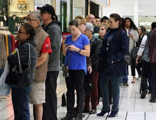 Voters line up to cast their ballots during the second day of early voting for the midterm elections Tuesday inside Bassett Place.