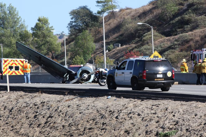 A World War II-era plane crashed into the center divider on Highway 101 near Agoura Hills on Tuesday.
