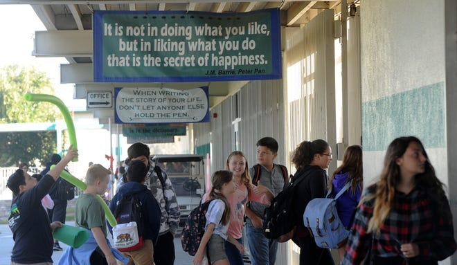 Students at Sinaloa Middle School walk to their next class in Simi Valley. The school has positive sayings throughout campus. It's part of a program being used by districts across Ventura County to make students feel connected to school.
