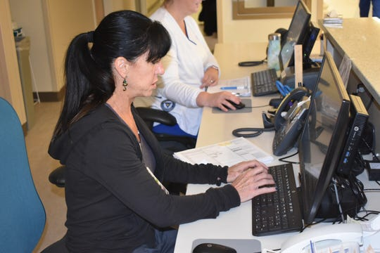 Maura Krell, nurse manager for the pediatric intensive care unit at Ventura County Medical Cetner, works at the nursing station. The unit opens Monday.