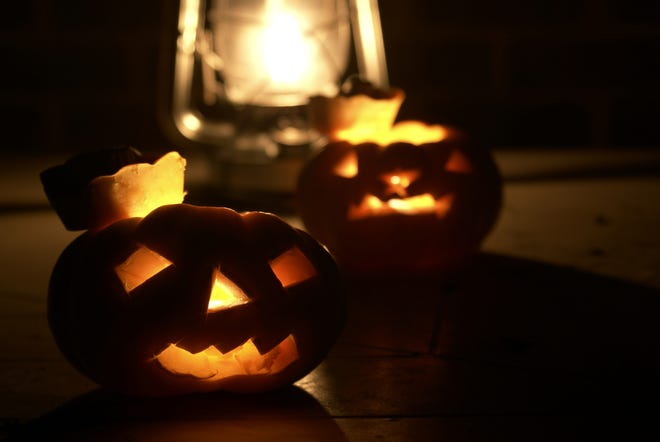 Halloween would not be halloween with out a pumpkin or two.  By night and when lit by candles their faces become more expressive of their purpose.