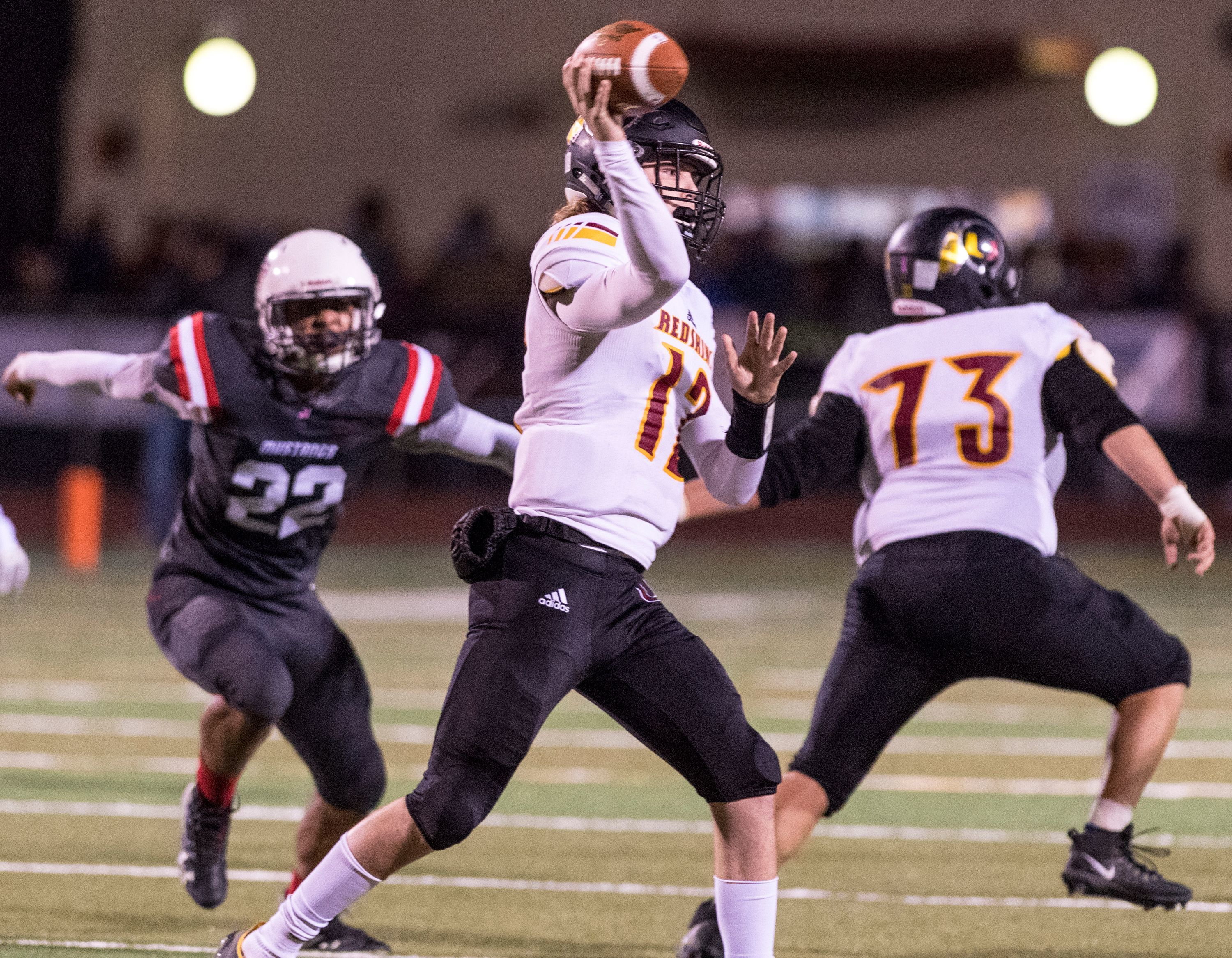 Tulare Union quarterback Nathan Lamb passes against Tulare Western in the annual Bell game at Bob Mathias Stadium on Friday, November 3, 2017. The Tribe have won the past two Bell Games.