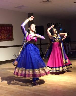 Dr. Swati Biswas, left, and Nimisha Patel dance at a past Diwali celebration.