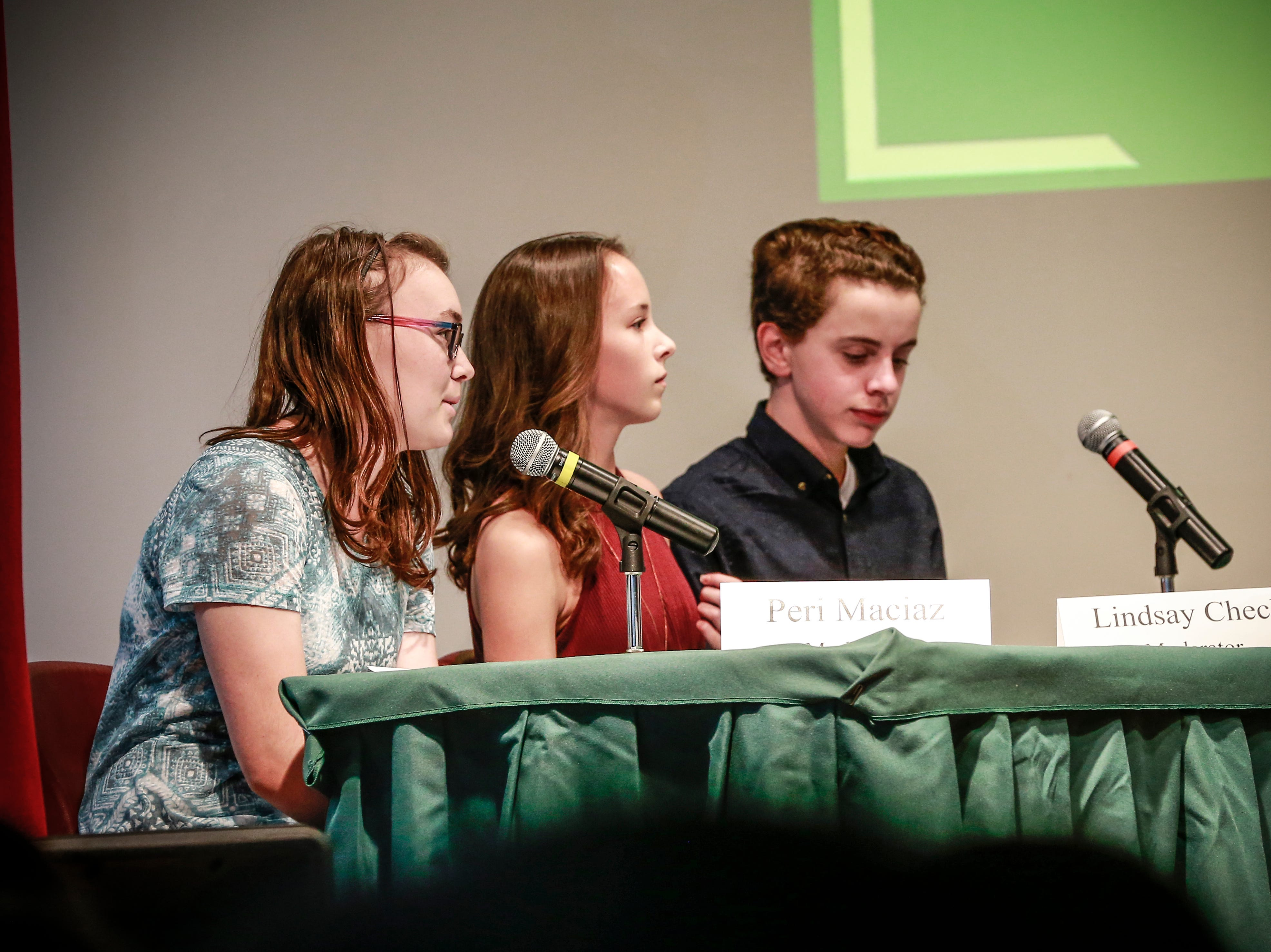 Moderators Peri Maciaz, left, Lindsay Check, and Aidan Morgan get their questions ready during the 9th grade Action Civics Political Forum Wednesday, Oct. 17, 2018, at D.C. Everest Junior High School auditorium in Weston, Wis. T'xer Zhon Kha/USA TODAY NETWORK-Wisconsin