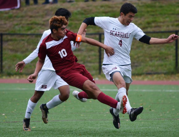 Ossining midfielder Alessio Hernandez gets a half step on Scarsdale's Nico Bernard and gets the Pride out in transition during the second half of a 1-0 win over the Raiders on Monday in a Section 1 Class AA quarterfinal.