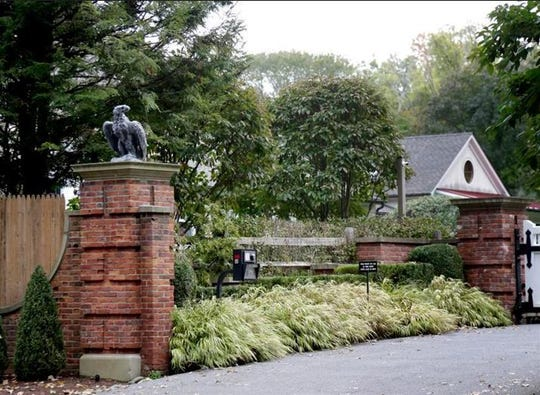 """The entrance to a house owned by philanthropist George Soros is seen in Katonah, New York, Tuesday, Oct. 23, 2018. A device found outside the compound """"had the components"""" of a bomb, including explosive powder, a law enforcement official said Tuesday."""