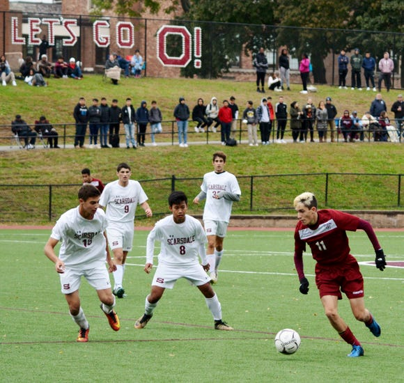 Ossining forward Mateo Marra turns and speeds forward to apply pressure Monday during the second half of a 1-0 win by the Pride in a Section 1 Class AA quarterfinal game.