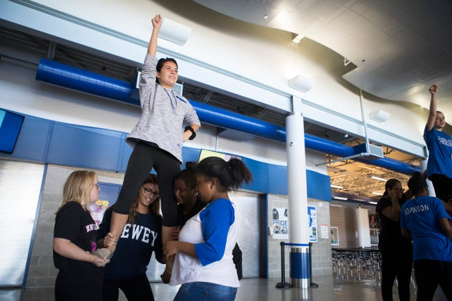 Middletown High School Unified Cheer team member Delaney Caguin practices with the squad Monday at Middletown High School.