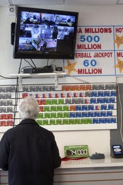 A customer fills out numbers Thursday, March 29, 2012, for the $540 million Mega Millions lottery at the Convenient Store on 9th and Orange Street in Wilmington, Delaware.