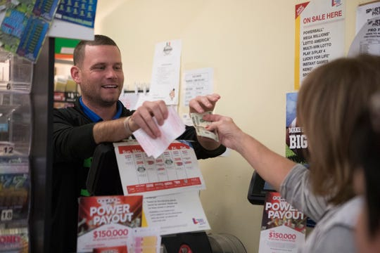 People line up and purchase lottery tickets at Jack's Country Maid Deli near Elsmere in 2018 for Mega Millions' $1.6 billion jackpot.