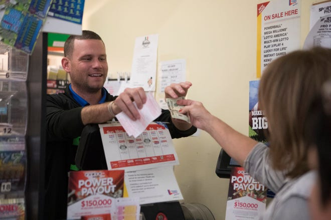People line up and purchase lottery tickets at Jack's Country Maid Deli Tuesday evening before the Mega Millions drawing. Tuesday night's Mega Millions drawing is worth an estimated $1.6 Billion.