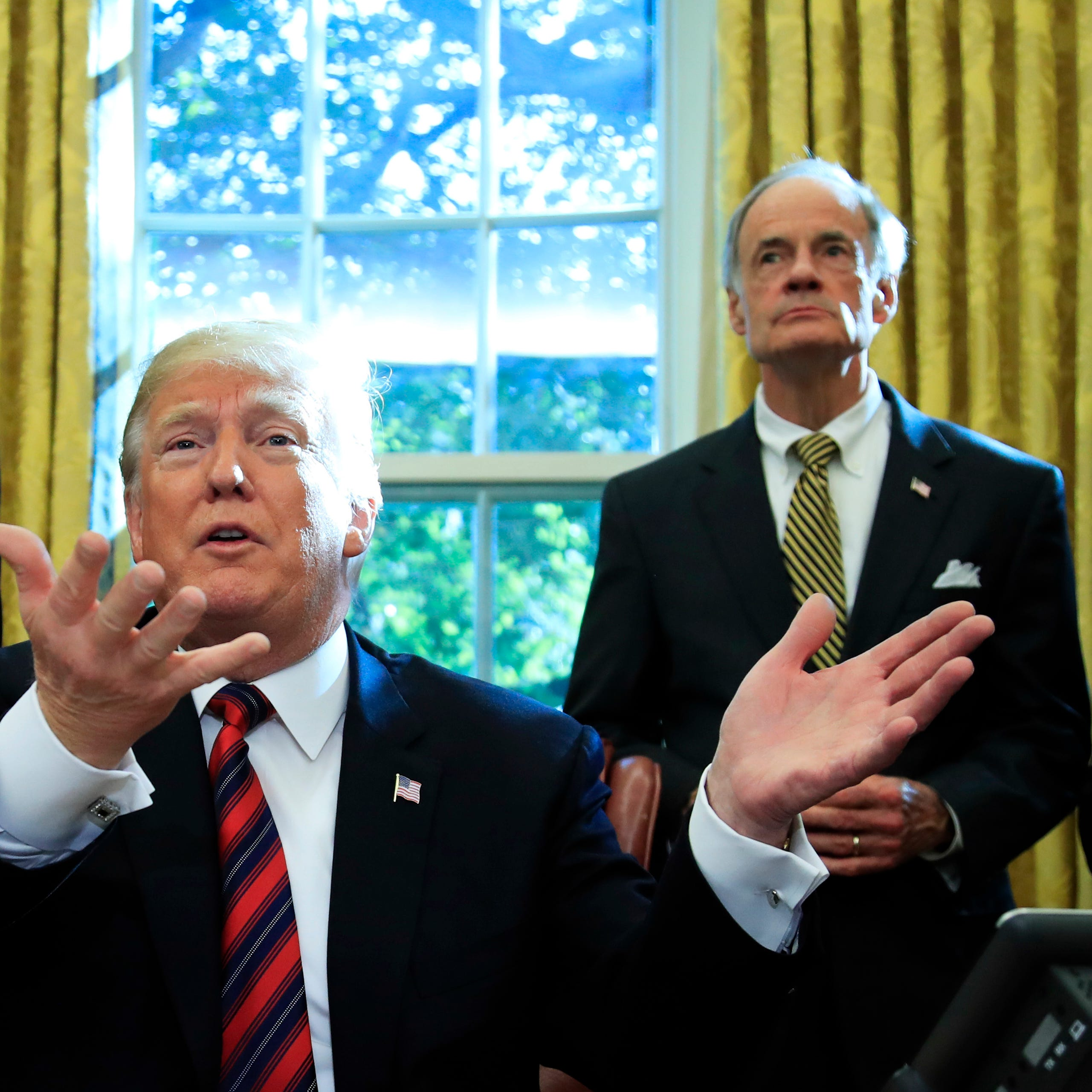 Carper waits out Trump 'ramblings' on Saudi Arabia, migrant caravan after bill signing