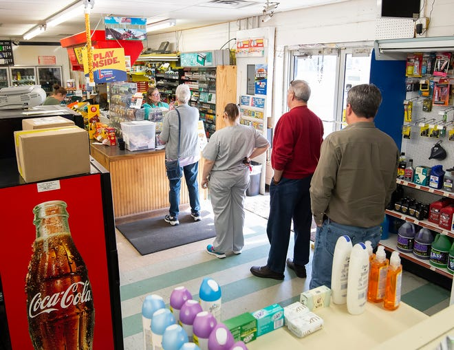 Customers wait in line to purchase Mega Millions lottery tickets at Bodie's Dairy Market in Millsboro.  Tuesday night's Mega Millions drawing is worth an estimated $1.6 Billion.
