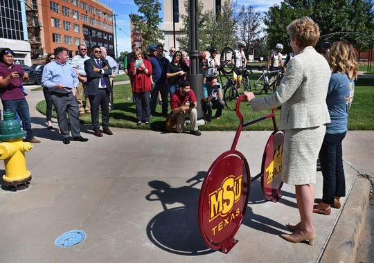 A crowd of community leaders and interested individuals gathered Tuesday afternoon for the unveiling of the new MSU Texas bike rack at Scott Avenue and 8th Street.