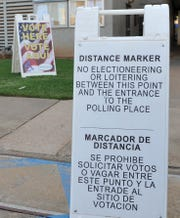 A sign placed outside of the Wichita County courthouse marks one-hundred feet from the polling place doors.