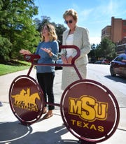 Jana Schmader, left, executive director of Downtown Wichita Falls Development, and Dr. Suzanne Shipley, president of Midwestern State University, talks about the relationship between MSU and downtown after unveiling the new MSU bike rack at 8th Street and Scott Avenue.