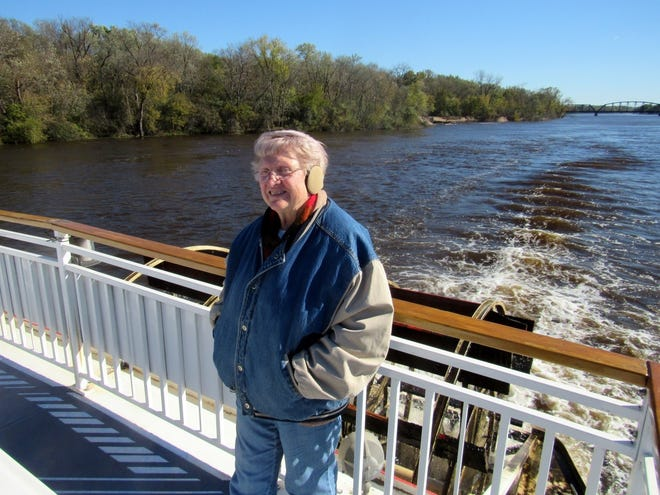 Columnist Susan Manzke braves the chilly autumn winds to enjoy the bright sunshine while cruising the Mississippi River.