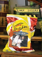 In celebrating their wedding anniversary, Lynda and Gary had potato chip bags printed with their wedding photo.