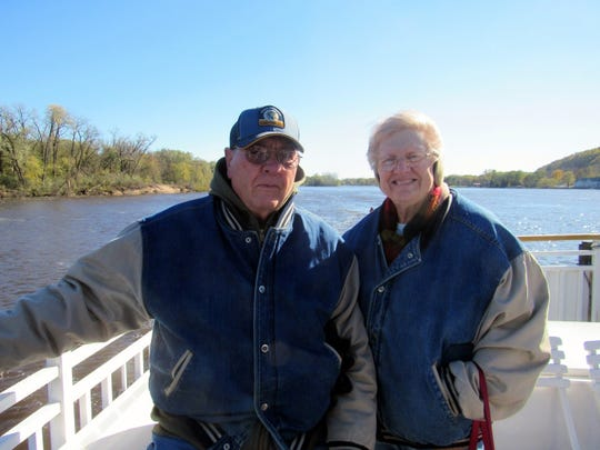 Bob joins Susan on deck as they cruise the Mississippi River during a fall excursion.
