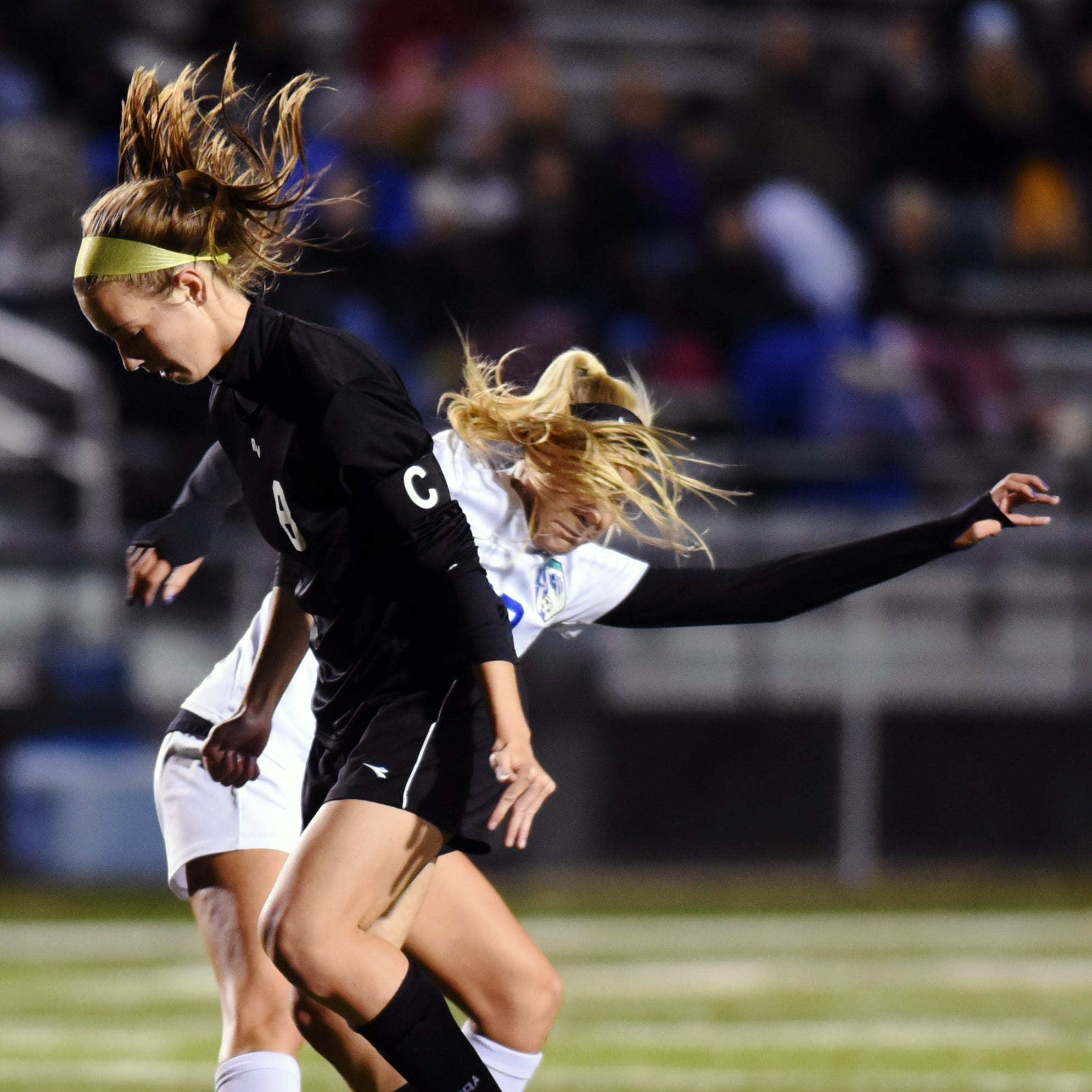 River View's Emmie Brenly, left, and Zanesville's Valerie Hickman fight for the ball during their Division II district semifinal on Monday in Coshocton.