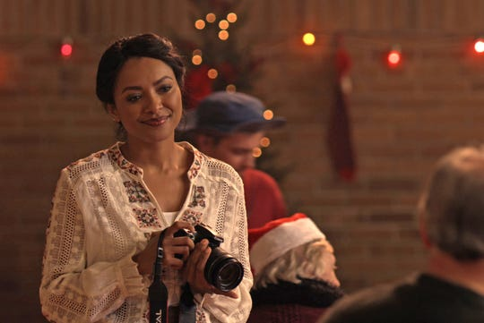 "Kat Graham stars in Netflix's Christmas rom-com ""The Holiday Calendar."""