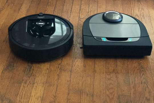 A side-by-side look at the robot vacuums: Roomba, left, and Neato, right.