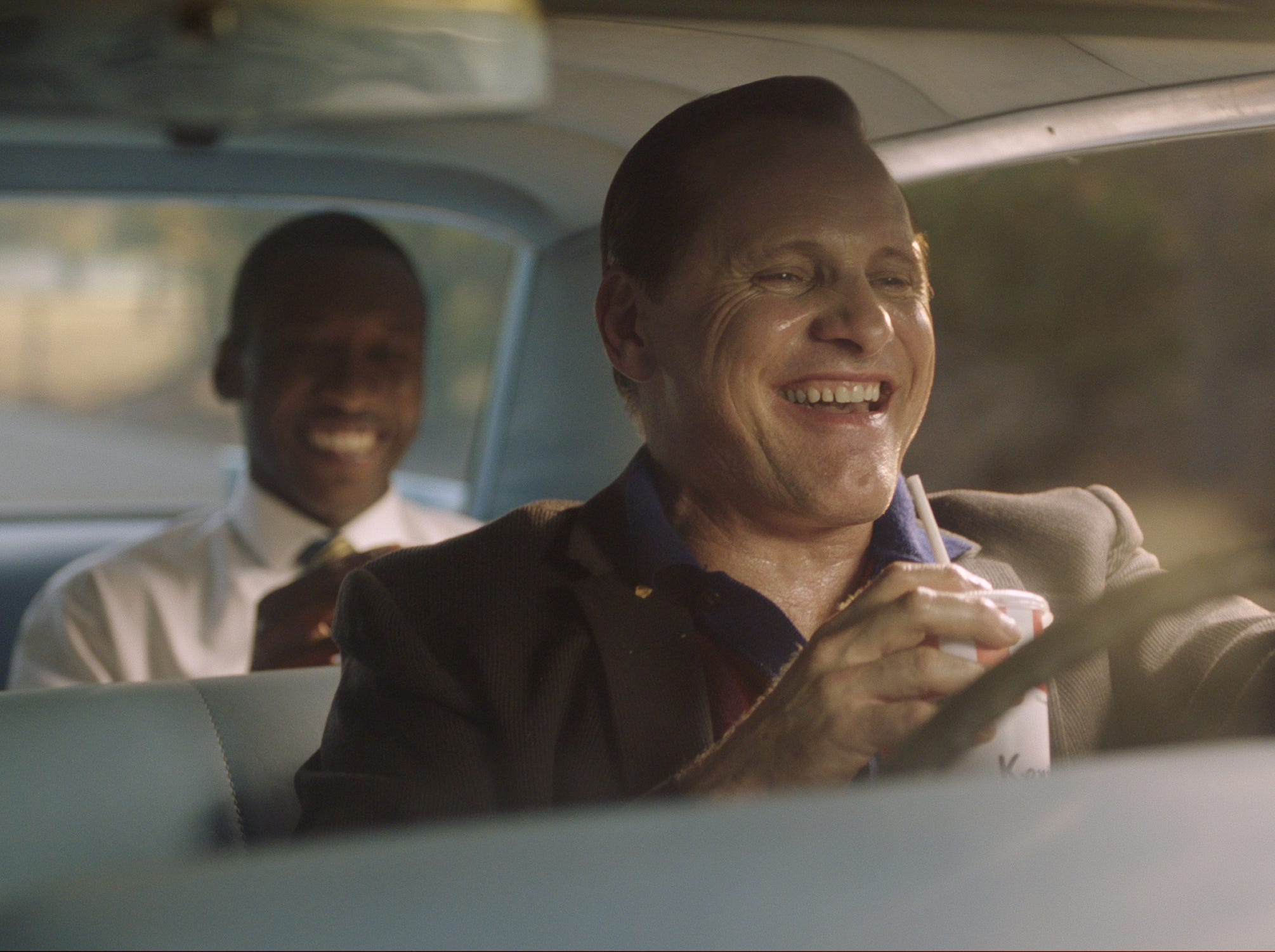 """Tony Lip (Viggo Mortensen, right) is driver, confidante and security for famous pianist Don Shirley (Mahershala Ali) on a 1962 concert tour of the South in the comedy-drama """"Green Book."""""""