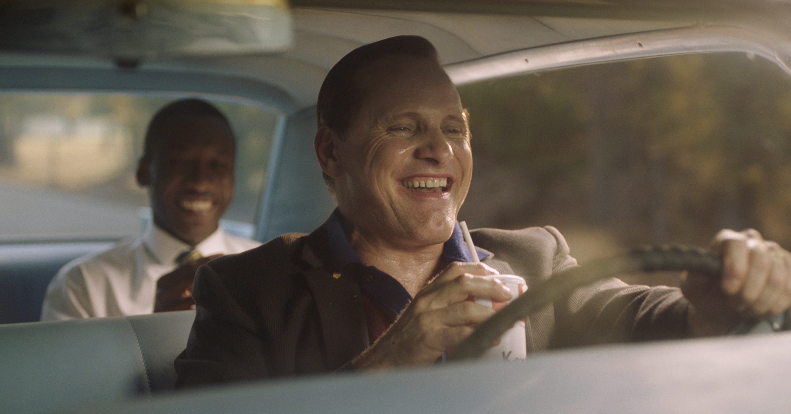 """Tony Lip (Viggo Mortensen, right) introduces Don Shirley (Mahershala Ali) to the wonders of Kentucky Fried Chicken on a 1962 concert tour of the South in the comedy-drama """"Green Book."""""""