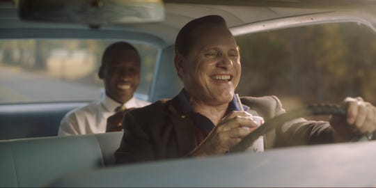 "Tony Lip (Viggo Mortensen, right) is driver, confidante and security for famous pianist Don Shirley (Mahershala Ali) on a 1962 concert tour of the South in the comedy-drama ""Green Book."""