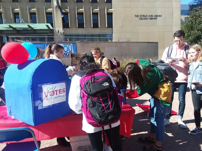 "Students at George Washington University drop off absentee ballots Oct. 18, 2018 at a ""Party at the Mailbox"" event."