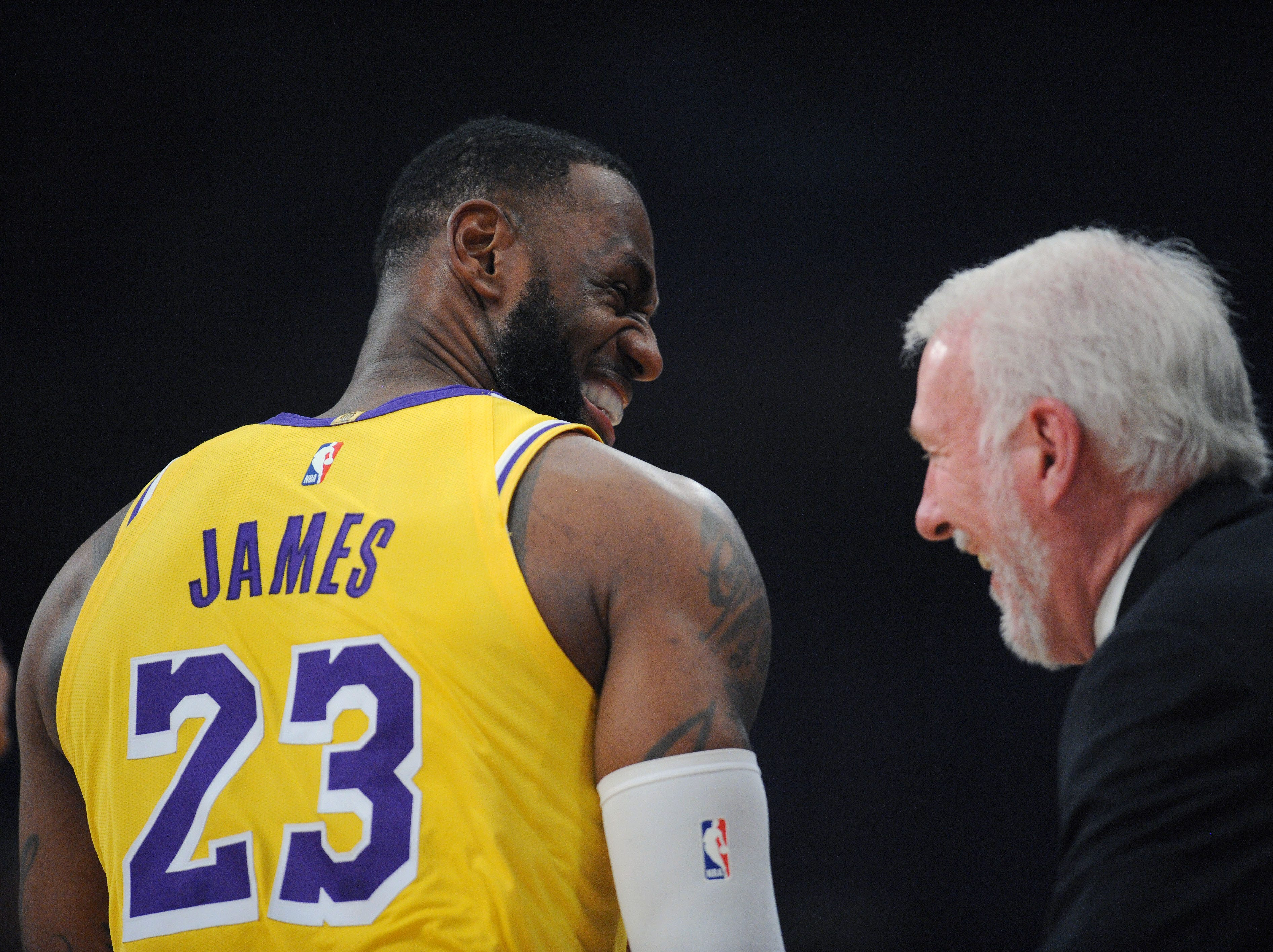 Oct. 22, 2018: James shares a laugh with Spurs coach Gregg Popovich before playing San Antonio at Staples Center.